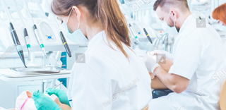 stock-photo-young-dentistry-students-having-practical-classes-on-anatomical-models-on-stomatology-course-387464680